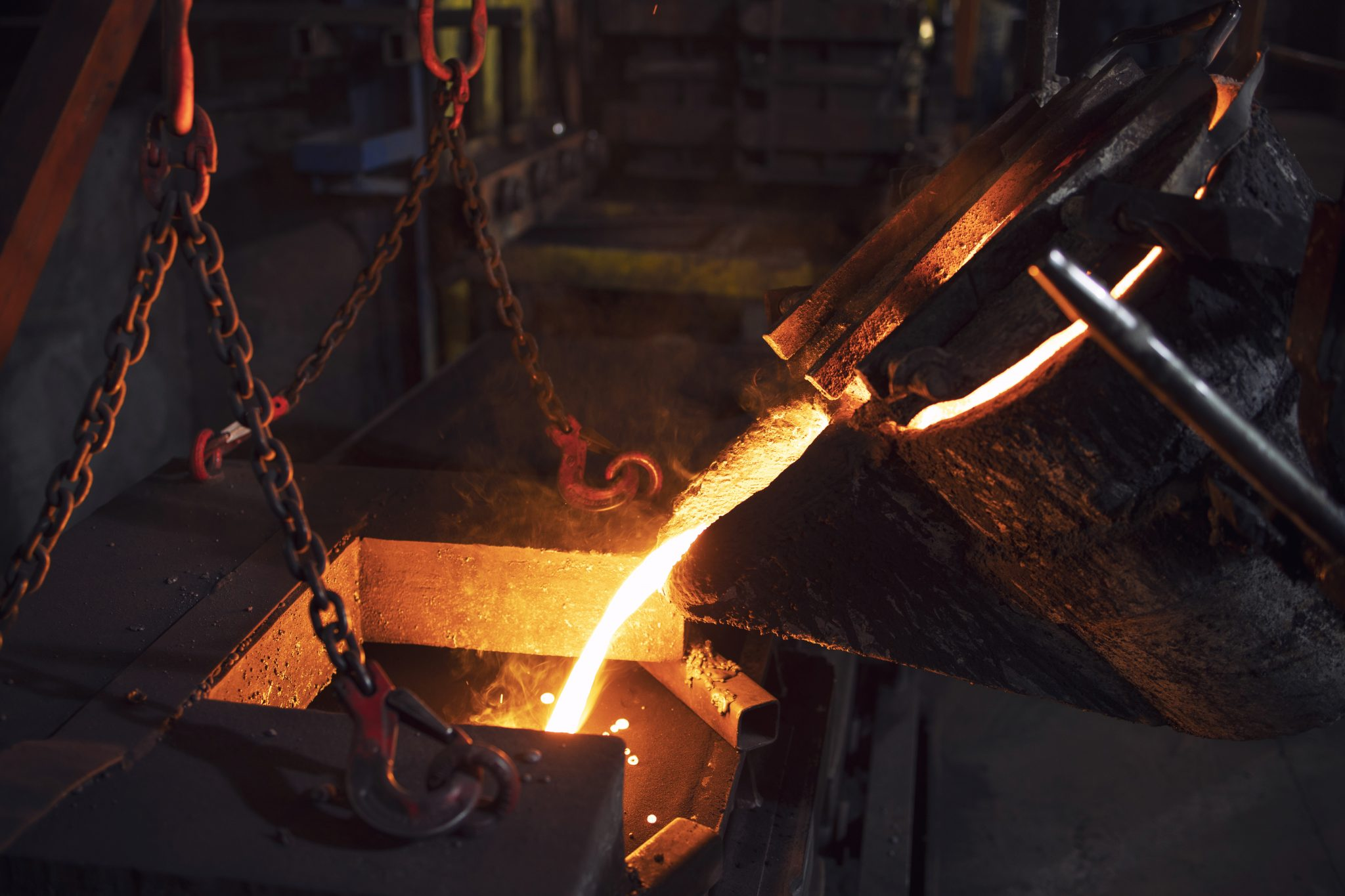 Filling cast with molten iron in foundry. Metallurgy and industry.